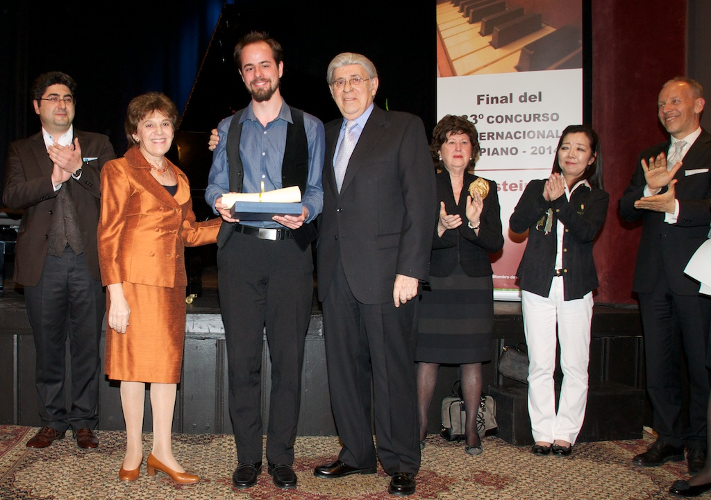 Michael Davidov accompanied by Prof Delia Steinberg and jury president.